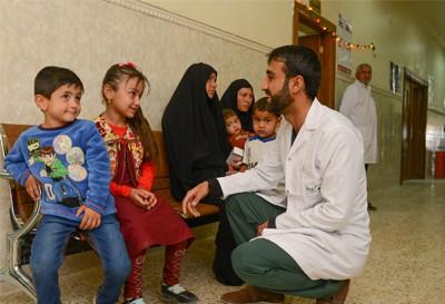Volunteer doctor with children